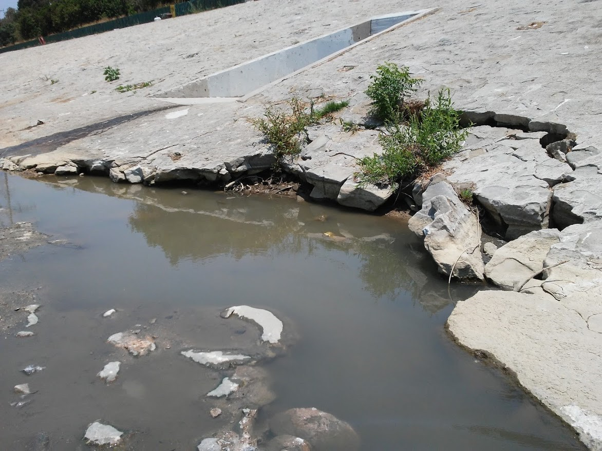 damaged levee exposed as water drawn down