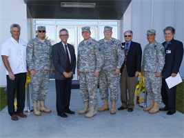 Rep. Alan Lowenthal, third from left, takes part in ribbon cutting ceremonies Jan. 12 for the newest addition to the Joint Forces Training Base in Los Alamitos, Calif.; the 79th Sustainment Support Command's 53,000 square-foot U.S. Army Reserve Center. Joining Lowenthal are, from the left, contract partner Todd Gillum, 40th Inf. Div. Commander Brig. Gen. Keith Jones, 79th SSC Commander Maj. Gen. William D. Frink, Jr.,  63rd Regional Support Command Commander Maj. Gen. Michael Schweiger, Cypress Mayor Pro Tem Leroy Mills, Los Angeles District Commander Col. Mark Toy, and Los Alamitos City Councilman Dean Grose. The nearly $29 million project is managed by the Corps and includes a state-of-the-art 12,500 square-foot organizational maintenance shop and more than 28,000 square-feet in organizational parking.