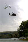 An Army National Guard Blackhawk helicopter executes a simulated rooftop evacuation on the set of a new recruitment commercial filmed at Whittier Narrows Park near Los Angeles.  The National Guard and the commercial's director, Zach Snyder, worked with the Los Angeles District to obtain filming permits for the shoot. (USACE photo by David A. Salazar)